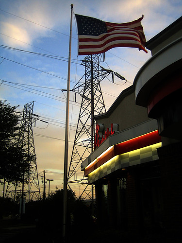 Chick-fil-A, American flag, electric lines, sunset in Austin, TX