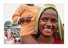 Smile of the smile (Elishams) Tags: portrait woman india smile tattoo child indian traditional faith culture uttaranchal tribe hindu indianarchive hinduism pilgrimage inde pilgrims haridwar theface haryana northindia  harkipauri indedunord 50millionmissing theindiatree