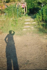 self shadow portrait (nilgun erzik) Tags: travel shadow sea summer vacation sun holiday selfportrait green film me grass analog turkey afternoon village minolta trkiye turkiye august 2006 ishootfilm turquie antalya journey nophotoshop yingyang deniz dalyan kemer olympos myra lycia yaz fethiye ky akdeniz srt gezi mediterrenean koy tatil nilgun myfavouriteplace likya minoltasrt cirali seyahat gocek filmcameras gcek ral asitis kumluca minoltasrt303b nilgunerzik yavuzpansiyon fotografkiraathanesi tahtalidagi nilgnerzik tahtalda