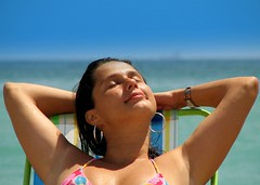 Wake me up when September ends (neloqua) Tags: ocean blue sea summer brazil portrait woman sunlight beach southamerica water girl beautiful smile face smiling riodejaneiro wonderful happy daylight fantastic perfect colorful joy monalisa adorable sunny bluesky summertime earrings resting moment lovely charming magical niteroi sunnyday
