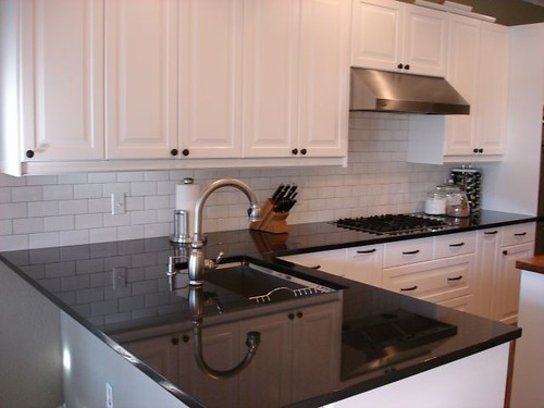 Our Semi Finished White Kitchen But With Black Countertop, Stainless  Appliances, And Wood Floors: