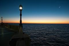 Luces en la baha (Javier Martinez de la Ossa) Tags: sunset espaa moon andaluca luna puestadesol cdiz farolas ocaso atlntico ocano horaazul bahiadecdiz javiermartinezdelaossa