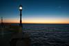 Luces en la bahía (Javier Martinez de la Ossa) Tags: sunset españa moon andalucía luna puestadesol cádiz farolas ocaso atlántico océano horaazul bahiadecádiz javiermartinezdelaossa