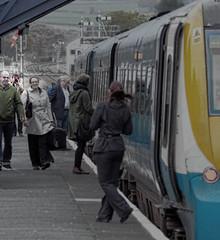 Him Taking Me Taking Him (whosoever2) Tags: england people station train nikon shropshire platform railway passengers cravenarms arrivatrainswales class175 d7100