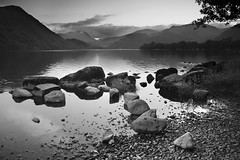 Still Dusk (B+W) (ben_thedriver) Tags: old autumn sunset summer england blackandwhite orange cloud sun colour reflection green film water grass rock clouds contrast canon walking landscape eos mirror golden landscapes early high still woods rocks warm raw quiet dusk ripple lakedistrict sigma hills clear filter lee bleak rest grad vignette goldenhour filmic waterscape constant ullswater filmlook constantlight ndgradfilter eos60d