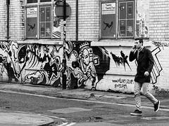 Northern Quarter #152 (Peter.Bartlett) Tags: manchester niksilverefex art unitedkingdom window people facade graffiti urbanarte noiretblanc peterbartlett cellphone streetphotography lunaphoto man urban poster candid uk m43 microfourthirds mobilephone bw olympuspenf sign blackandwhite doubleyellowlines monochrome
