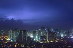 Manila night sky (Sumarie Slabber) Tags: manila philippines sumarieslabber nikon sky buildings city lights night lightning blue cityscape skyline dark bolts