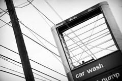 Tangling lines (KyleApl) Tags: blackandwhite monochrome signs lines bent wild tangled power powerlines sign pole gas station abandoned