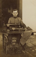 Regimental Tailor (kevin63) Tags: lightner photo sepia blackandwhite army british wwi sewing machine tailor trousers pants hemming treadle