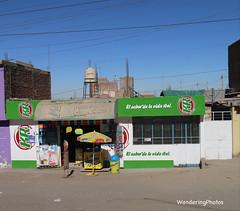 Shop with lone umbrella - Arequipa District Peru (WanderingPJB) Tags: green shopfrontage umbrella peru arequipa andes altiplano cmwdgreen