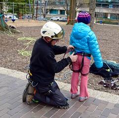 Arborist gears up girl in blue jacket 2 (Montgomery Parks, MNCPPC) Tags: treeclimbing woodsidepark january2017 2017