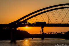 """Bridge Sunrise - Two Trucks"" by Patti Deters (Patti Deters) Tags: bridge orange sun art water minnesota vertical truck sunrise canon river mississippi photography mono design office colorful traffic stock lobby transportation vehicle hastings copyspace mn interiordesign sillhouette cafeart hastingsbridge canon70d pattidetersphotography pattideters"
