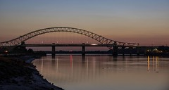 Sunset over River Mersey (joanjbberry) Tags: bridge sunset sky reflection water river island lights golden pentax mersey clearsky merseyriver runcorn k3 cameraclub rivermersey wiggs runcornbridge pentaxsmc silverjubileebridge runcorndocks moorecameraclub smcpentaxda18135mmf3556edalifdcwr pentaxk3 wiggsisland