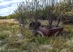 Taking a bite out of the industrial revolution... (Pat Kavanagh - Alberta, Canada) Tags: canada abandoned alberta homestead oldcar farmyard