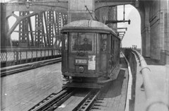 Wynyard-bound tram on Harbour Bridge (now twin roadways to Cahill Expressway), 1930-1939 / by Ted Hood (State Library of New South Wales collection) Tags: statelibraryofnewsouthwales