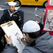 USS New York  Sailor Airman Aaron Waters gets a caricature drawn while visiting New York City's Times Square