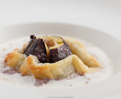 Tarte tatin of fig with espuma of cantal cheese. (annick vanderschelden) Tags: baked baking bakingpaper butter cooking dessert espuma figs foam hand humanhand incision oven pack pointofview preparation pressure puffpastry seeds step stick sugar tartetatin three two whitekitchenboard whiteplate belgium