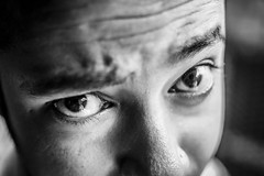Disbelief (arkamitralahiri) Tags: india indian blackandwhite monochrome eyes portrait people frown expression face funny closeup nikon d3100 35mm male candid
