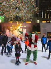 Violet And The Grinch On The Ice (Joe Shlabotnik) Tags: iceskating december2016 skating manhattan rockefellercenter statue prometheus 2016 newyorkcity grinch nyc violet fountain 60225mm