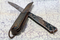 Painful History (Sir snap) Tags: knife knives map ww2 british german war macro sharp cut handled crossed secret spy soldier army pocket rust military