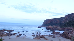 Morning at Andr Huts - Otter Trail (Rckr88) Tags: ocean travel sea sky cloud sun mountains water clouds sunrise southafrica coast rocks cliffs coastline gardenroute tsitsikamma easterncape ottertrail rockycoastline tsitsikammanationalpark