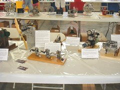 MEM Display at WEME Show, CA, 2015 (Miniature Engineering Museum) Tags: miniature engineering museum collection small model engine v 1 2 3 4 5 6 7 8 9 10 12 one two three four five six seven eight nine ten twelve cylinder jet airplane aircraft radial rotary inline opposed automobile car race boat hydro speed single dual over flat head cam valve gas flash steam stirling oil spark plug rimfire tether rc radio control precision machined machining prototype engineer craftsmanship builder craftsman display exhibit exhibition airport