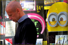 `1505 (roll the dice) Tags: life road uk england people urban man reflection london art classic film window glass weather fashion monster dave canon shopping hair advertising 3d eyes funny chelsea sad natural candid secret pair bald streetphotography sunny stranger rubber stuart kings unknown animation shops behind mad creatures googly unaware minions londonist kensingtonchelsea sw3 poretrait