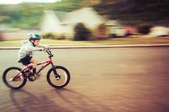 Intensity Rising (Jason _Ogden) Tags: street racing intensity riding nikon panning motion k2 helmet bmx flickrfriday bike rising d90 vr blurred intensityrising vr18200mm