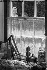 Weaver at Ulster Folk and Transport Museum (garylestrangephotography) Tags: travel vacation people blackandwhite woman white holiday black tourism wool window thread monochrome hat female canon eos grey mono uniform outdoor indoor roadtrip tourist tools curtains northernireland weaver performer trade weaving touristattraction loom travelphotography ulsterfolkandtransportmuseum touristlocation bangorcountydown garylestrangephotography