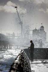 Fisherman - Brighton groyne_01 (a roving eye) Tags: sea beach pier fishing fisherman brighton wave groyne paulmansfield arovingeye