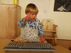 """""""Working."""" (quinn.anya) Tags: toddler keyboard sam serious daycare pointing cec sotd kotd733"""