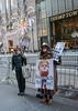 Outside Trump Tower (UrbanphotoZ) Tags: trumptower tiffanys women protesting selling impeachhisass ipaymoretaxesthantrump buttons bumperstickers cold barricade midtown manhattan newyorkcity newyork nyc ny