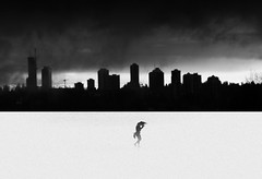 My little struggle (Tracy Linnel.) Tags: art silhouette contrasty blackandwhite skyline citybackdrop city buildings alone desert sand tracylinnel conceptual artistic people urban innamoramento