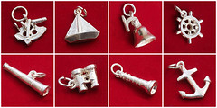 Vintage Sailors Christmas Sterling Silver Good Luck Charms (fstop186) Tags: christmas lighthouse vintage silver boat sailing bell good pudding binoculars telescope luck anchor sterling charms rare helm sextant