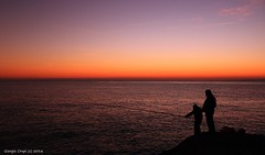 Fishermen at sunset - Merry Christmas (- Crupi Giorgio (official)) Tags: italy liguria genova camogli sea sky sunset fisherman reef relax seascape landscape canon canoneos7d sigma silhouette 1020 mm