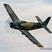 SKYRAIDER DOING A BANANA PASS WITH A FULL PROP DISK