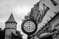 (Salut) Sibiu (DomiKetu) Tags: travel blackandwhite bw black clock film monochrome analog 35mm canon mono blackwhite ae1 romania canonae1 expired ilford fp4 sibiu xtol selfdeveloped homemadesoup blackwhitephotos