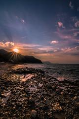 Sunset on the beach (Vagelis Pikoulas) Tags: november autumn sunset sea sun seascape beach rock canon landscape rocks view tokina sunburst 6d 2015 alepochori 1628mm alepoxwri