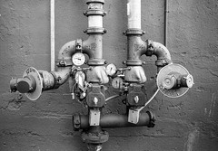 fittings (JoeBenjamin) Tags: city bw white black film blanco water rollei standing hydrant 35mm flow alley pipes tubes pipe retro contax valve works series 100 t3 pressure piping valves spigot gauges fitting fittings spigots pressurized pressurize neiro