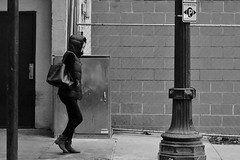 Bundled Up (burnt dirt) Tags: houston texas downtown town city mainstreet street streetphotography building wall people person girl woman bw cold coldweather asian jacket puffyjacket walk walking bag ponytail