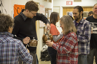Aaron Hughes Serves Tea to Members of Witness Against Torture at the Breaking of a Week-Long Fast