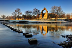 Winter Abbey (images@twiston) Tags: winter boltonabbey dawn dawnatboltonabbey ruins augustinian priory parish churchofsaintmaryandsaintcuthbert churchofstmaryandstcuthbert bolton abbey monastery sunlight golden hour yorkshiredalesnationalpark river wharfe dissolutionofthemonasteries 1154 devonshire estate northyorkshire stone imagestwiston morning national park yorkshire stepping stones blue sky cloudless frost frosty cold freezing reflections tree trees branch branches landscape dales reflected godsowncountry le longexposure 10stopnd rocks pebble rock pebbles tributary brook flowing stream wow