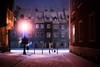 searching (ewitsoe) Tags: ryenk oldmarket snow snowstorm snowing winter lady shooting camera drift townhouses poznan poalnd staryrynek old zima ewitsoe erikwitsoe nikond80 35mm street city urban poland cute colorful night evening