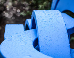 Blue bench in raindrops