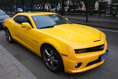 """China Beijing side street with yellow Camaro on show - """"Vroooom!"""" (moreska) Tags: china car colorful asia driving bright outdoor dusk beijing kingdom voiture camaro licenseplate chevy carro vehicle parked streamlined middle luxury coupe musclecar imports lateafternoon sidestreet sportcar usmade pricey performancecar candycolors"""