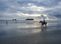 Sunset ride (halifaxlight) Tags: ocean sunset horse beach clouds reflections island costarica swimmers rider walkers manuelantonio