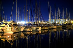 On the mirror (explored 2016/12/31) (Fnikos) Tags: port boat sea water waterfront sky skyline night nightview light reflection mirror city architecture serene vehicle outdoor