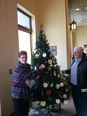 """MARIE ANGEL AND BOB RACHEL ARE TAKING NAMES OFF OF THE GIVING TREE IN THE NARTHEX. STOP BY AND TAKE A NAME TO HELP SOME ONE HAVE A BETTER HOLIDAY. • <a style=""""font-size:0.8em;"""" href=""""http://www.flickr.com/photos/98129408@N05/31225763410/"""" target=""""_blank"""">View on Flickr</a>"""