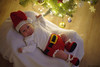 Santa's Little Helper (Puljak) Tags: pentax pentaxk1 pentaxfa50mmf14 newyear christmas christmastree christmaslights christmaspresent santa santaclaus baby babyboy underthetree indoor blanket cradle rocker crochet crochetclothes babycrochet