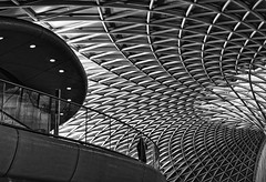 watching (plw1053) Tags: kingscross station architecture highcontrast structure mono monochrome blackandwhite bw pattern persons standing watching plw1053 paullgwells interior building london londonstreets lights lighting curve bnw windows metal frame glass modern contrast travel railway